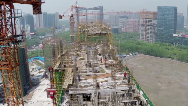 Busy construction site and cranes in modern city,aerial view. video