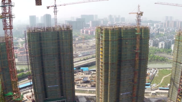 Busy construction site and cranes,aerial view. video