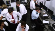 Busy customer services team or stock broker company video
