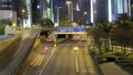 Busy freeway running through high rise buildings in Hong Kong video