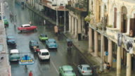 Busy Havana street with cars and people video