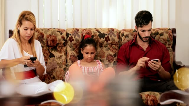 Busy Hispanic Family At Home Using Mobile Phones Telephones Smartphones video