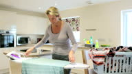 Busy ironing in the Kitchen video