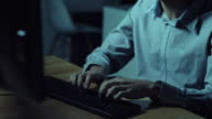 Busy man working on the computer at night video
