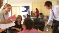 Busy office scene and young people video