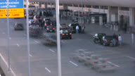 Busy road driveway near Airport terminal. Traffic, people, cars, luggage. video