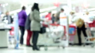 Busy store with people rushing video