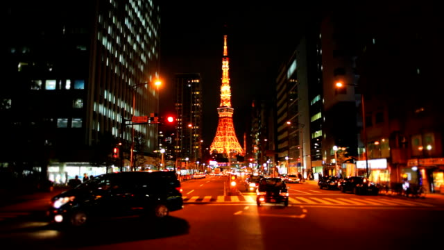 Busy street at night with Tokyo Tower video