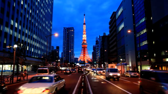 Busy street at night with Tokyo Tower. video