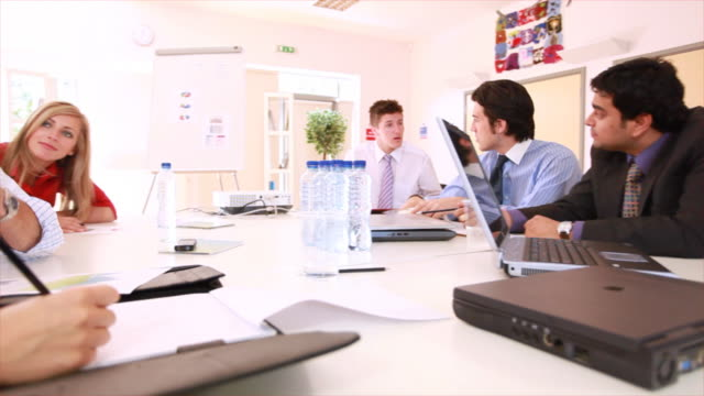 Busy team boardroom workers video