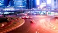 Busy traffic circle and pedestrian walking on footbridge at night,time lapse. video