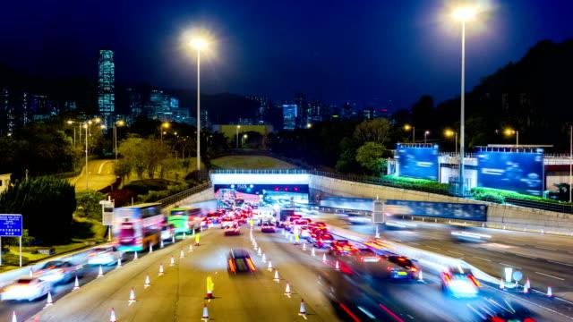 Busy Traffic Going Into Tunnel at Night. 4k Tight Still Shot. video