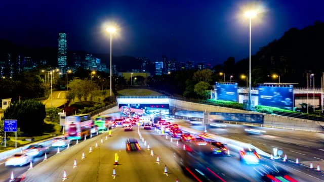Busy Traffic Going Into Tunnel at Night. 4k Wide Still Shot. video