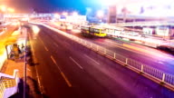 Busy traffic in Beijing near bus station at night, timelapse. video