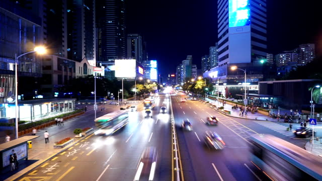 Busy traffic on multiple lane highway and buildings in shenzhen at night,time lapse. video