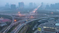 busy traffic on road junction with cityscape and skyline of hangzhou binjiang district at sunset. timelapse 4k video