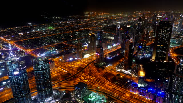 Busy traffic scene in the rush hour on Sheikh Zayed Road, Dubai's main road artery, night time lapse, 4k video