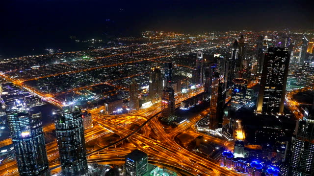 Busy traffic scene in the rush hour on Sheikh Zayed Road, Dubai's main road artery, night time lapse video