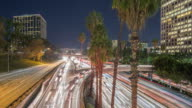 busy traffic through modern city at night in los angeles,timelapse,4k video