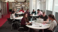Busy University Library With Students And Tutor video