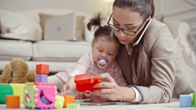 Busy woman combining business and motherhood video