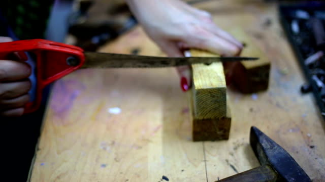 Busy woman tinkering in workshop. video