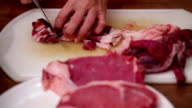 Butcher in action - chopping side steak with sharp knife video