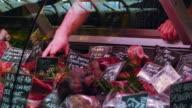 Butcher Offering Meat Specialities In A London Market (UHD) video