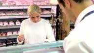 Butcher Serving Customer In Shop video