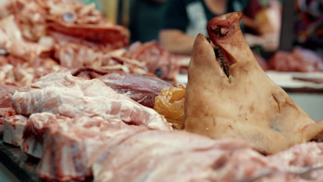 Butcher's row. Different meat and pork's head on the stall video