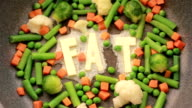 Butter melting on hot pan with vegetables video