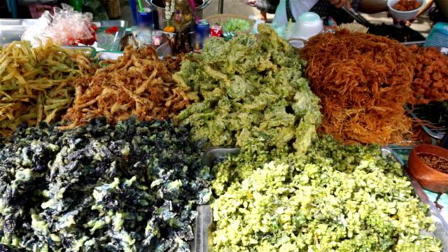 Buy spicy thai appetizer at market, Thailand (Panning shot) video