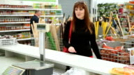 buyer behind the counter with the cashier video