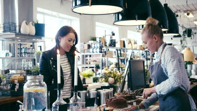 Buying cake in a nice modern cafe video