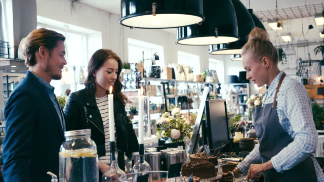 Buying cake in a nice modern cafe (slow motion) video