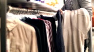 Buying clothes at retail store mirror. video