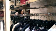 Buying clothes at retail store. video