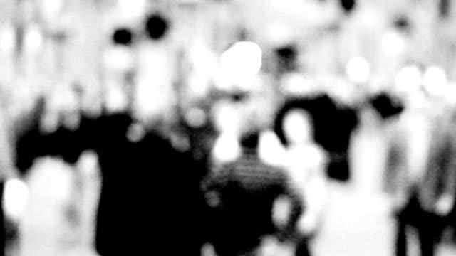 B/w defocused anonymous crowd video