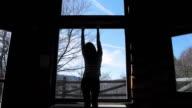 Cabin Retreat - Video of a young woman enjoying a beautiful day. video
