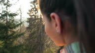 Cabin Retreat - Woman admiring the view in nature. video