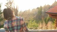 Cabin Retreat - Woman enjoying the view. video