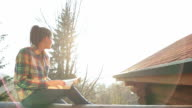Cabin Retreat - Woman reading and relaxing. video