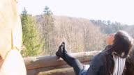 Cabin Retreat - Woman relaxing outdoor. video