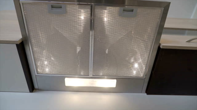 A cabinet hood inside the kitchen video