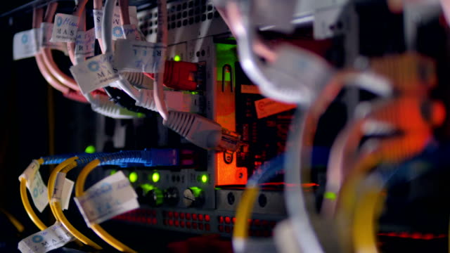 Cables and lights at data Center Servers. Backview. 4K. video