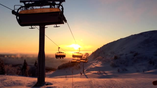 cableway in the sunrise light in ski resort video