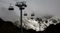 Cableway with open seats in mountains in cloudy weather video