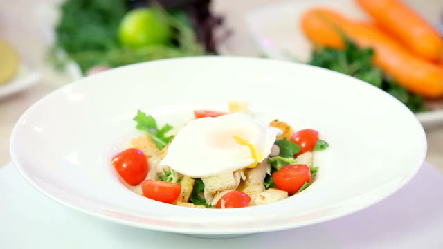 Caesar salad with poached egg video