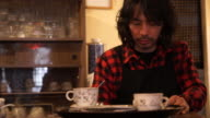 Cafe owner working in their own cafe video