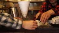 Cafe owners are passing coffee to customers video